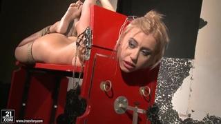 Estella licks Nikky Thorne in bondage action