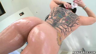 Casey Cumz oils her big butt and natural boobs and poses in front of the camera