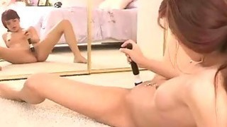 Redhead babe masturbates with vibrator in mirror