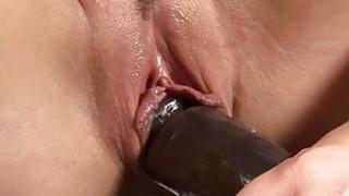 Hot brunette rides a big black dildo