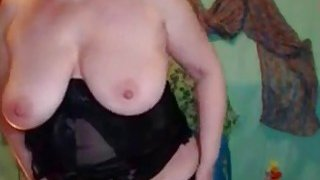 Busty mature with glasses masturbating