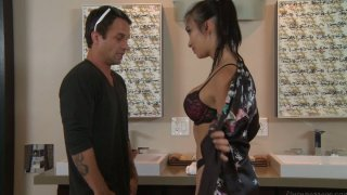 Japanese brunette Katsuni blows and rides dick in bathroom